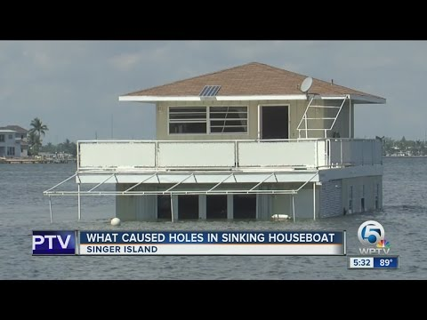 What caused holes in sinking houseboat
