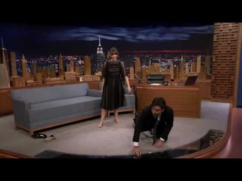 Felicity Jones takes her shoes off. Bare feet on the Jimmy Fallon show