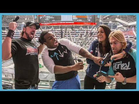 Superstars compete in WWE 2K16 Big Screen Battle on the massive AT&T Stadium's video screen thumbnail