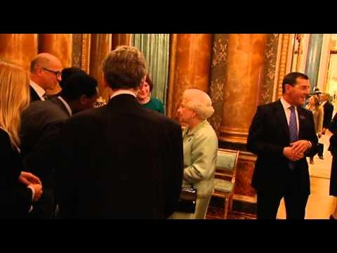 Queen Elizabeth II hosting a media reception at Buckingham Palace ahead of her Diamond Jubilee