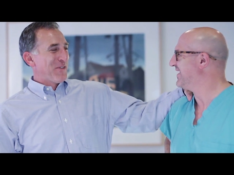 Dr. Marshal Peris surprises Ed, one of his many spine surgery patients.