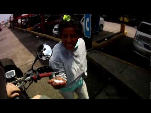 Crazy Woman Attacking Cars in Panama