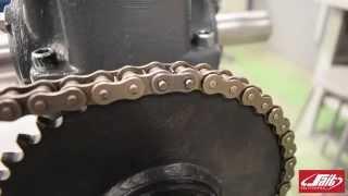 Drive chain slack adjustment
