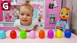 Gaby opens Surprise Eggs with Toys
