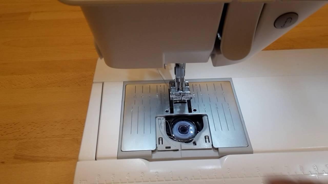 Symaskine Torvet - Fjern trådsammenfiltring under stingpladen