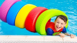 Ali playing in swimming pool, Learn colors with colored tires