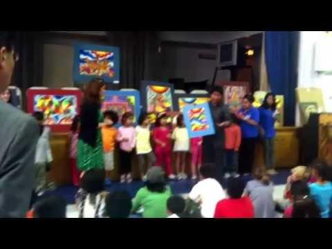 Bolivian artist Roberto Mamani Mamani visits the Escuela Bolivia Program