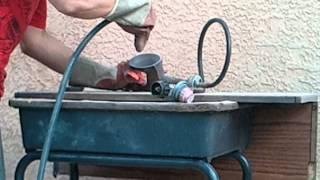 """Home made """"sand blaster"""" """"pot blaster"""" removing rust from propane burner."""