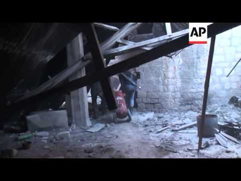 FSA fighters use explosive charges to target Syrian soldiers