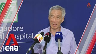 Singapore PM Lee Hsien Loong speaks to reporters after receiving COVID-19 vaccine