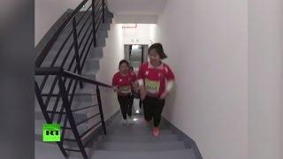 На 64 этажа здоровее  в Китае прошёл забег по лестницам небоскрёба