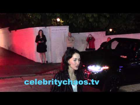 Sandrine Holt comes over to greet  briefly outside hollywood party