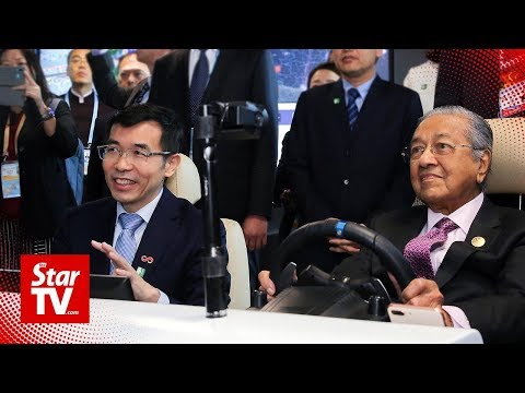 Dr Mahathir gets first-hand AI experience with self-driving car in Beijing
