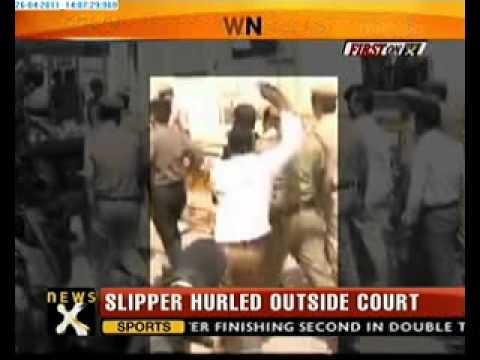 Slipper hurled at Suresh Kalmadi, attacker detained