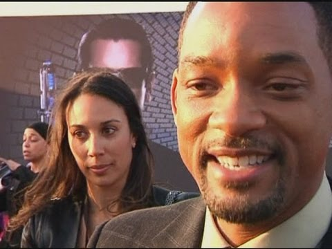 Scantily clad woman joins Will Smith on the red carpet for Men in Black 3 premiere in Berlin