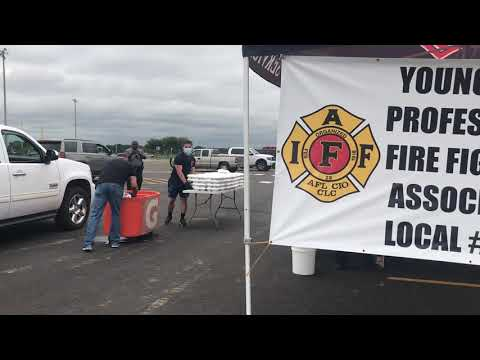 Youngsville Firefighters and Police Officers distribute 1,000 jambalaya plates to community