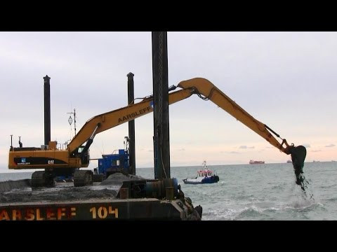 Cat 385C Long Reach Excavator Moving Sand In The Ocean