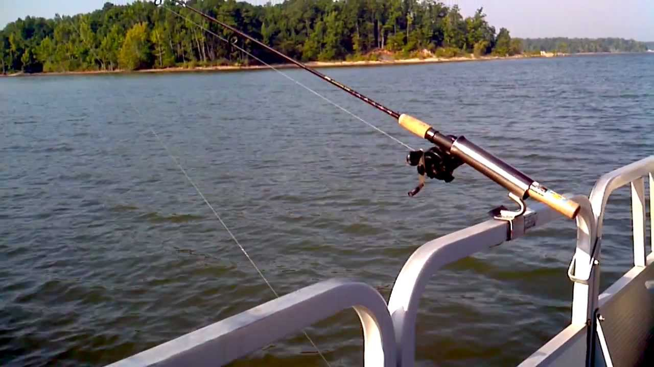 Pontoon boat fishing rod holder no drilling no bolts for Homemade fishing rod holders for boats