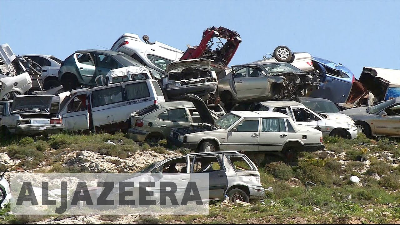 Israeli scrap cars sold illegally in West Bank - YouTube