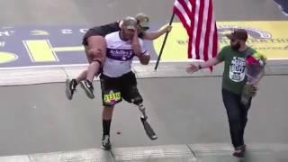 Vet with prosthetic leg carries guide across Boston Marathon finishline