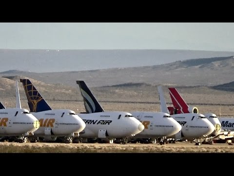 Airplane graveyard with Boeing 747s and other aircraft parked in Mojave Desert, California (2 clips)