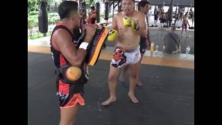 Kru Sawat (Yodnapa) smashing pads with Kru Fon