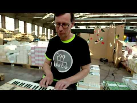 Rammstein: Flake Lorenz play a song in a German TV [CC/ English]