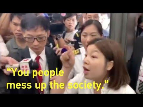 Woman grabs U.S. flag from HK rioters: 'You people mess up society' 香港女子奪走暴徒手中的美國國旗:你們在擾亂社會!