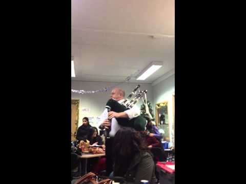 Mr Lees on his bagpipes at George Salter Sixth Form