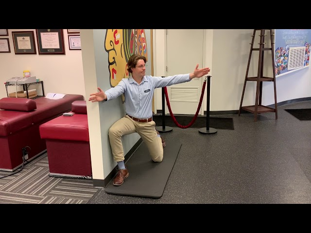 Kneeling Thoracic Rotations with Wall