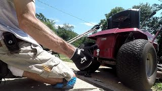 Installing a trailer ball on a riding lawnmower.