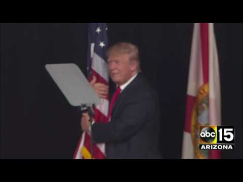 Donald Trump takes the stage and hugs an American flag in Tampa, Florida