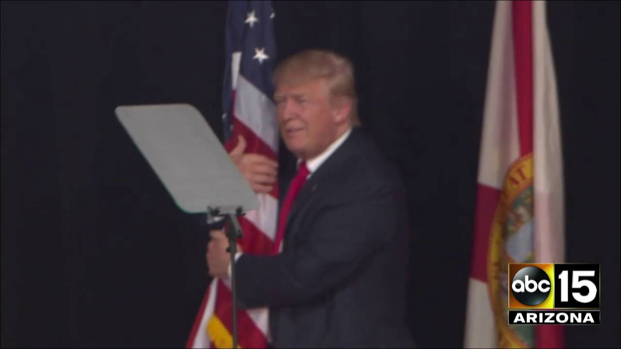 Donald Trump Takes The Stage And Hugs An American Flag In Tampa Florida Youtube