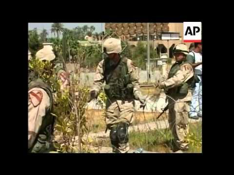 Reactions to handover, security in capital, new Iraqi flag flies