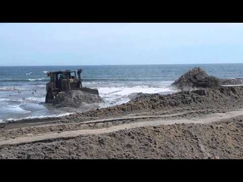 Bulldozers working on the Rockaway Beach, Queens