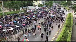 Hong Kong protesters marching past Po Lam Estate