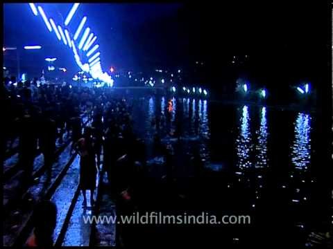 Devotees offering big lighting candles to pampa river