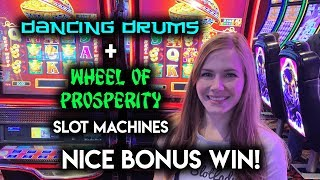 8-80-spin-dancing-drums-and-wheel-of-prosperity-phoenix-slot-machine-bonus-win