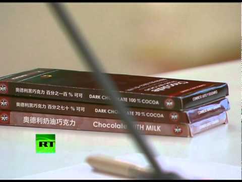 Choco Chavez: Sweet treat for Medvedev at Kremlin conference 'ad break'