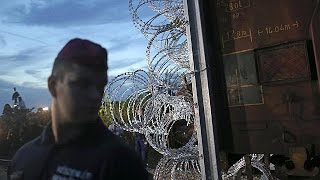Hungary seals border with razor wire
