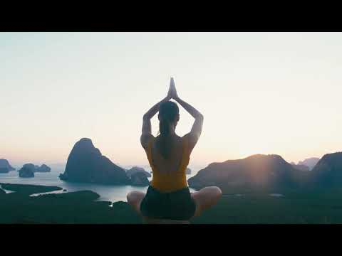 videoblocks woman doing yoga fitness exercise at famous landmark viewpont phang nga bay in sunrise a