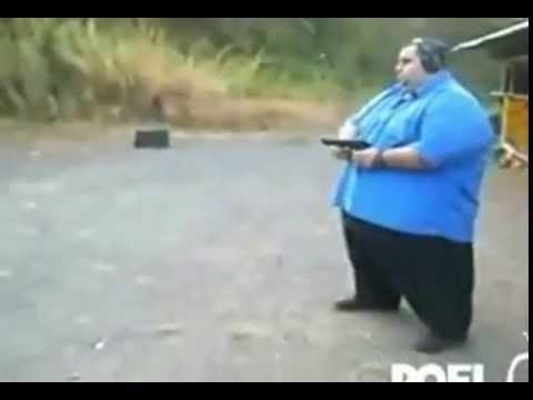 fat guy shooting gun