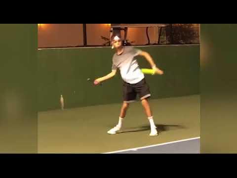 Romeo Beckham plays a game of tennis with Caroline Wozniacki