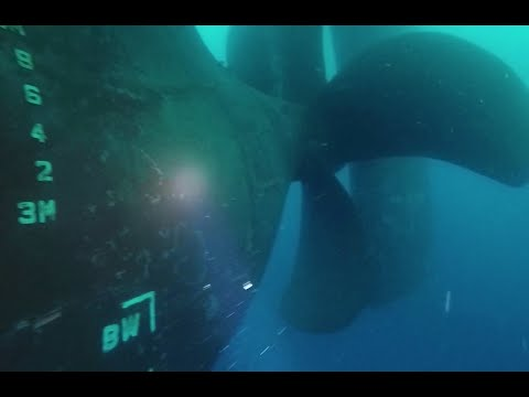 Tanker vessel underwater inspection by divers.