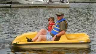 Catherine and her dad going paddle boating on Lake of Bays, Muskoka, Ontario Canada