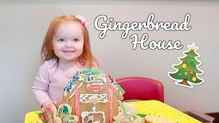 TODDLER DECORATES GINGERBREAD HOUSE!