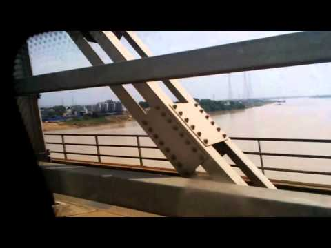 M.C omowesco on the river Niger Bridge 'Trip to the Eastern Part of Nigeria""