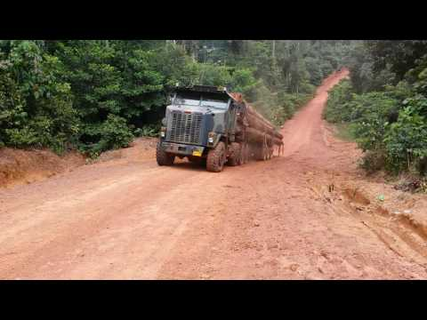 Wrongly loaded Oshkosh logtruck can`t climb a steep mountain