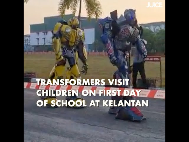 Transformers Visit Children On First Day of School at Kelantan