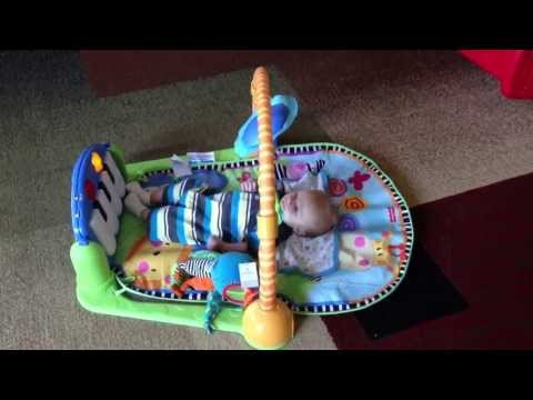 6-week-old-baby-playing-with-fisher-price-discover-'n-grow-kick-&-play-piano-gym